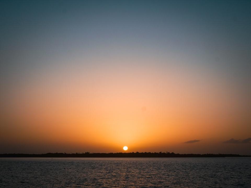 Coucher de Soleil sur le traversier de l'île Holbox - Roadtrip 10 jours au Mexique - Blog Voyage Ma Folie Vagabonde